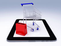 Shopping Cart over Tablet PC. E-commerce Concept. Royalty Free Stock Photography