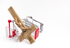 Shopping cart overturned with crucifix on the ground Stock Photo