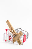 Shopping cart overturned with crucifix on the ground Stock Image