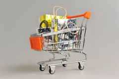 Shopping cart with packages on gray Stock Image