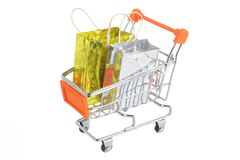 Shopping cart with packages isolated on white Royalty Free Stock Photos
