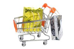 Shopping cart with packages isolated on white Stock Photography