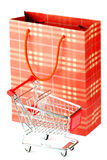 Shopping cart and paper bag Stock Image