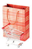 Shopping cart and paper bag Royalty Free Stock Image