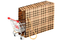 Shopping cart and paper bag Royalty Free Stock Images