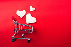 Shopping cart and paper heart Royalty Free Stock Photos