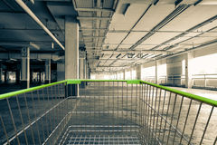 Shopping cart in Parking garage interior, industrial building,Em Stock Photography