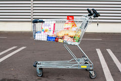 Shopping Cart In Parking Lot Stock Photography