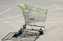 Shopping cart at parking lot Stock Photography