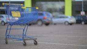 Shopping cart on parking. stock video footage