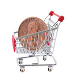 Shopping cart with penny Royalty Free Stock Image