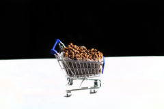 Shopping cart with pet food Royalty Free Stock Photos