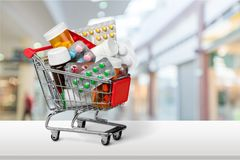 Shopping Cart with pills isolated on  background. Shopping cart pills color image red object Stock Photography