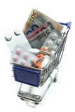 Shopping Cart with pills and money Royalty Free Stock Image