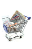 Shopping Cart with pills and money Stock Photo