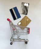 Shopping cart with plastic cards Stock Images