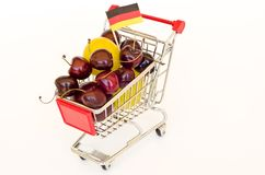 Shopping cart with plum and cherry Royalty Free Stock Photo