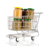 Shopping cart with pots canned vegetables Stock Images