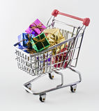 Shopping cart with presents. Isolated on white Royalty Free Stock Images
