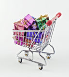 Shopping cart with presents Royalty Free Stock Photography