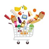 Shopping cart with purchases Royalty Free Stock Photo