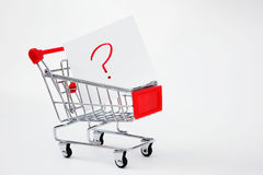 Shopping cart with question. Shopping cart close up shot,  looking for solution or answers Royalty Free Stock Photos