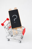 Shopping cart with question. Shopping cart close up shot,  looking for solution or answers Stock Photo