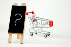 Shopping cart with question Royalty Free Stock Photography