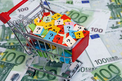 Shopping cart with question marks on one hundred euro banknotes.  Royalty Free Stock Photo