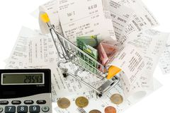 Shopping cart, receipts and money Royalty Free Stock Image