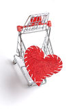 Shopping cart and red heart Stock Photo