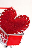 Shopping cart and red heart Stock Photos