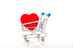 Shopping cart with red heart Royalty Free Stock Images