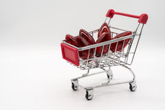 Shopping cart with red light bulb royalty free stock images