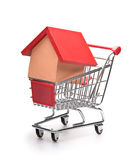 Shopping cart with red roofed house Royalty Free Stock Photo