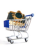 Shopping cart with retro gold camera Stock Photos