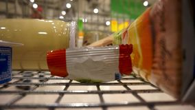 Shopping cart rides through the store. Shopping cart with a few items rides through the store. View from inside the shopping cart stock footage