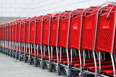 Shopping cart in a row. Red shopping cart in a row Royalty Free Stock Photo
