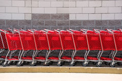 Shopping cart in a row. Red shopping cart in a row Stock Photos