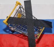 Shopping cart on Russia flag Stock Image