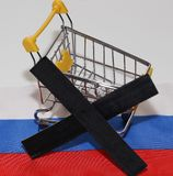 Shopping cart on Russia flag Stock Photos