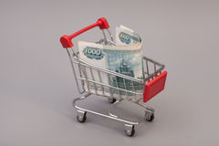 Shopping cart with Russian ruble Royalty Free Stock Images