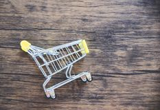 Shopping cart on rustic wooden background / Online shopping black Friday concept stock photos