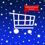 Shopping cart with sale board. Shopping cart with a christmas sale board Royalty Free Stock Photo