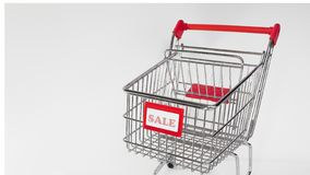 Shopping cart with Sale sign. royalty free stock photography