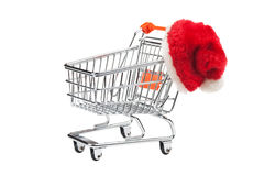 Shopping cart and Santa Claus hat Royalty Free Stock Images