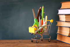 Shopping cart with school supply. Back to school concept Royalty Free Stock Images