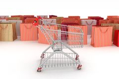 Shopping cart and shopping bags Royalty Free Stock Photography