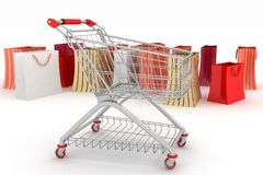 Shopping cart and shopping bags Royalty Free Stock Images