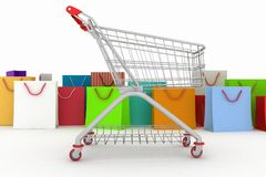 Shopping cart and shopping bags Stock Photography